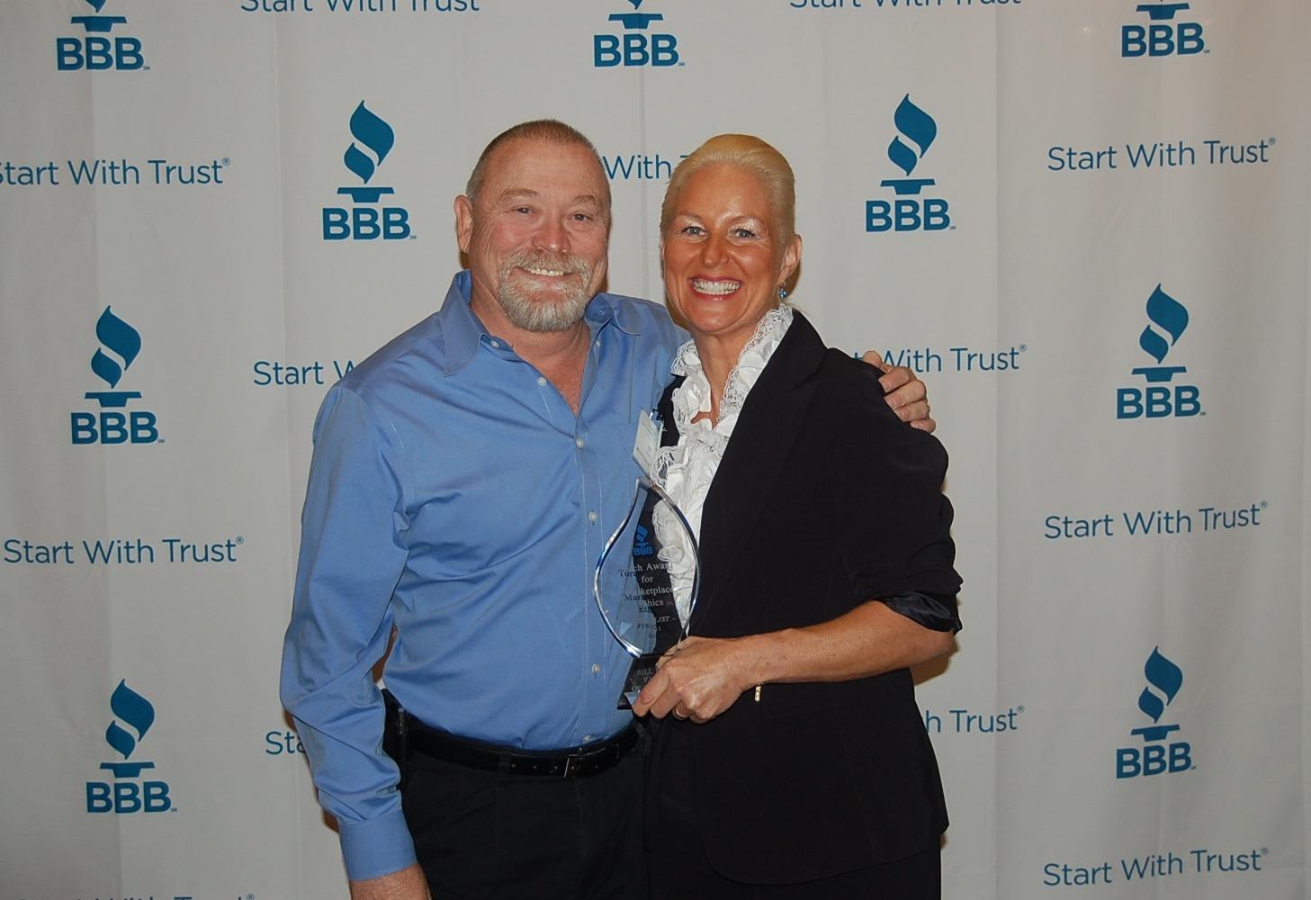 San Diego Plumbing Company owners, Bill and Tina Howe accepting the BBB Torch Award